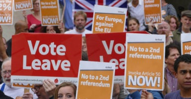 Supporters of Britain leaving the European Union call on the government to invoke a provision known as Article 50, which would allow formal negotiations on the exit to begin. (Photo: Gail Orenstein/NurPhoto/Sipa USA/Newscom)