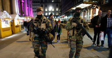 Belgium soldiers patrol in the Brussels Christmas market after the terror alert was lowered. Nov. 27, 2015. (Photo: Oliver Hoslet/EPA/Newscom)