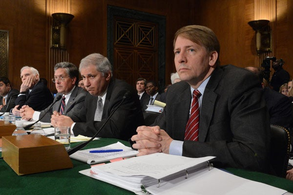 Consumer Financial Protection Bureau Director Richard Cordray (right) at a hearing on banking reform.