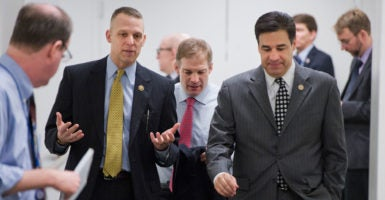 House Freedom Caucus members such as Rep. Raúl Labrador (right), want a bill to fund the government to extend into next year. (Photo: Tom Williams/CQ Roll Call/Newscom)