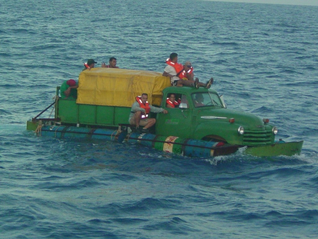 Necessity facilitates ingenuity as demonstrated by these refugees who turned a 1951 Chevy into cruiser. They were stopped by the Coast Guard in June 2003 and returned to Cuba. (Photo: U.S. Coast Guard, Cuban Migrant Collection)