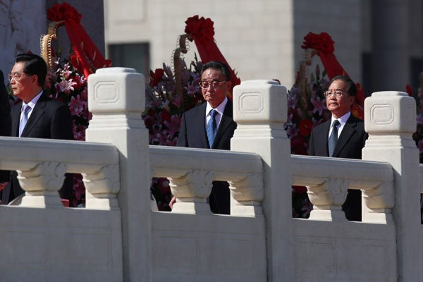 (L-R) Chinese President Hu Jintao, Chairman and Party Secretary of the Standing Committee of the National People's Congress Wu Bangguo, and Premier Wen Jiabao. (Photo: EPA/Newscom)
