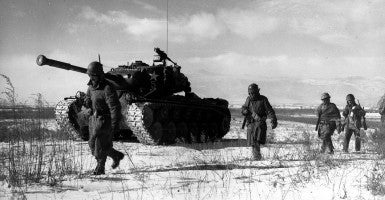 A column of the U.S. 1st Marine Division move through Chinese lines during their breakout from the Chosin Reservoir. (Photo: Wikimedia)