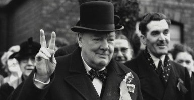 Conservative Party Leader Winston Churchill gives his familiar victory sign. He was making a last-minute campaign tour before the General Election. Woodford, Essex. Feb. 23, 1950. (Photo: Everett Collection/Newscom)