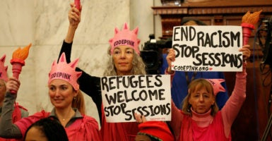 Protesters held signs at the Senate Judiciary Committee confirmation hearing for Sen. Jeff Sessions, R-Ala., to become U.S. attorney general on Jan. 10, 2017. (Photo: Kevin Lamarque /Reuters/Newscom)