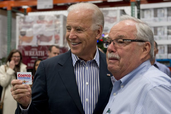 Vice President Joe Biden with Costco co-founder Jim Sinegal at the Washington, D.C., store. (Photo: AFP/Newscom)