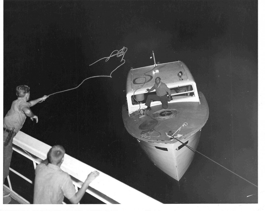 The U.S. Coast Guard answers the distress signal of a Cuban speed boat and tows it to the Keys in November 1965. (Photo: U.S. Coast Guard Camarioca Boatlift Collection)