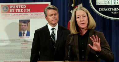Acting Assistant Attorney General Mary McCord speaks in front of a poster of a suspected Russian hacker during a news conference at the Justice Department in Washington, March 15, 2017. (Photo: Yuri Gripas/Reuters /Newscom)