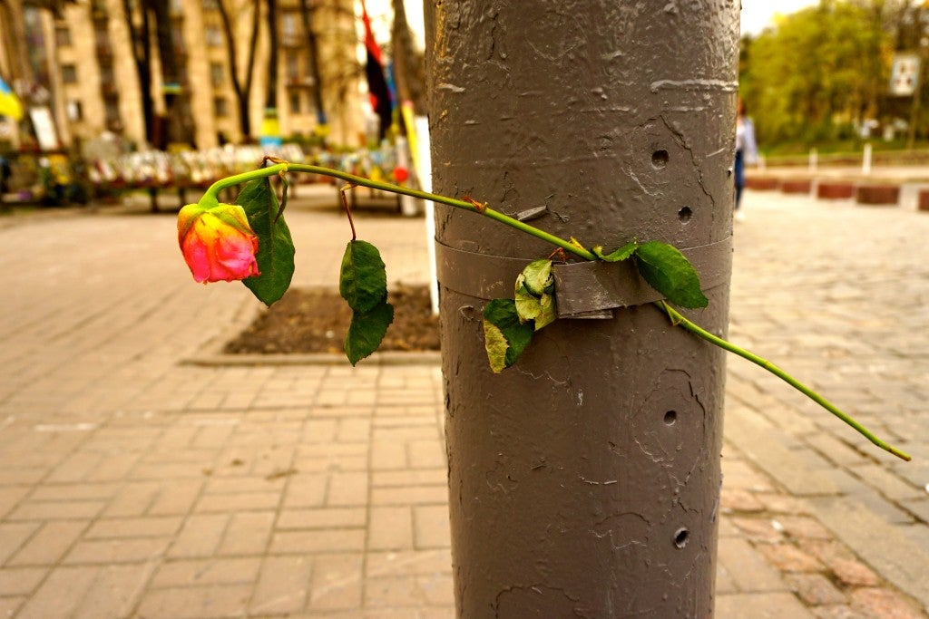 Bullet holes still mark a street sign post in central Kyiv, a reminder of the 2014 revolution. (Photo: Nolan Peterson/The Daily Signal)