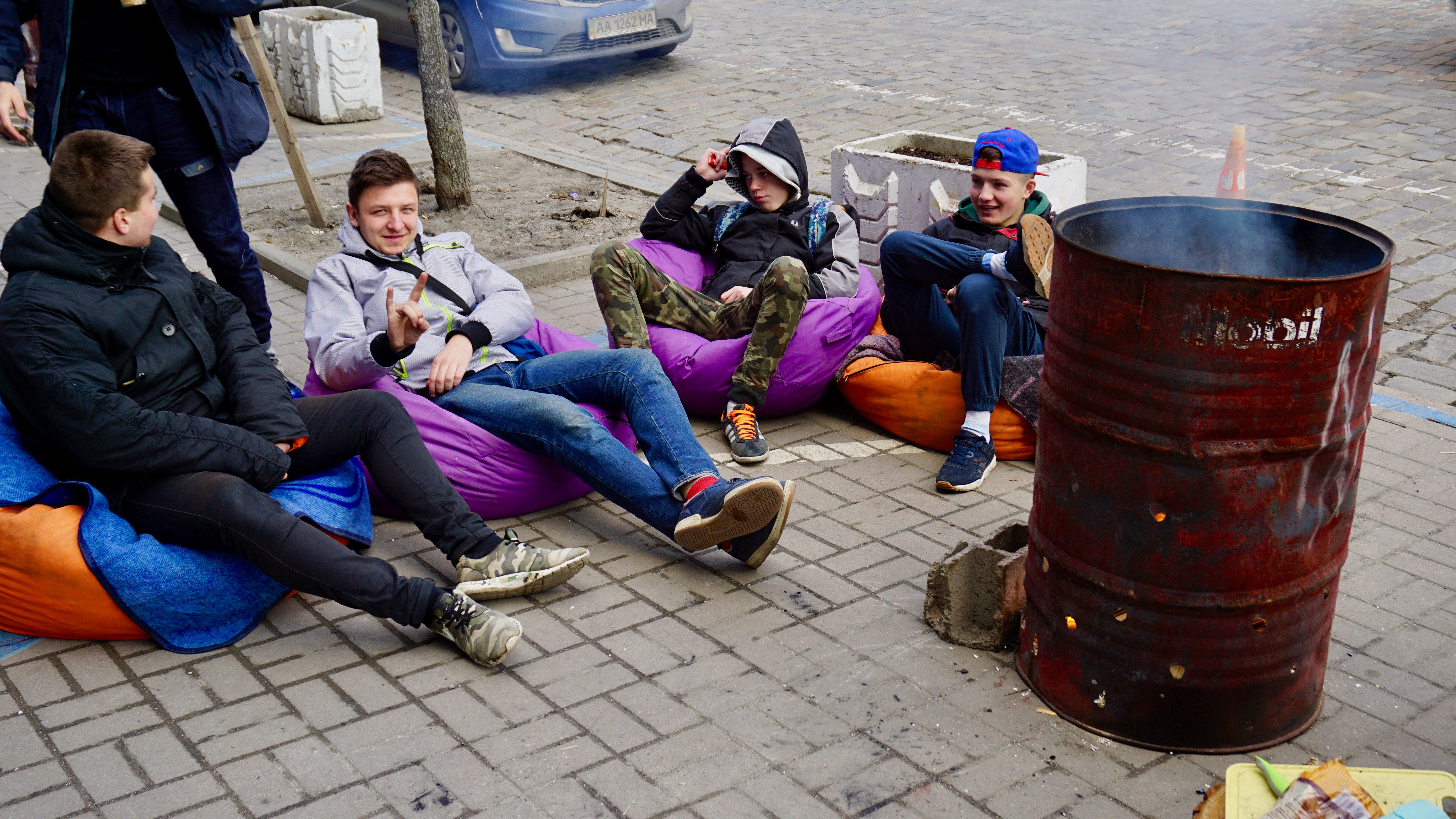 Protesters keep warm while camped out in front of the Sberbank branch in central Kyiv. (Photos: Nolan Peterson/The Daily Signal)
