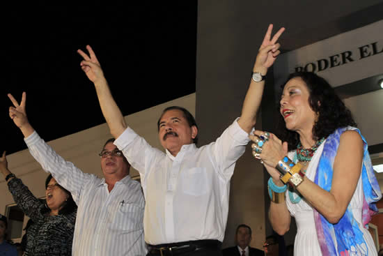 Nicaragua's President Daniel Ortega greets supporters after he was certified by the Supreme Electoral Council (CSE) as president from 2012 to 2016, while flanked by his wife Rosario Murillo (R) and Vice President Omar Hallesleven in Managua January 9, 2012. Ortega will be sworn in on Tuesday for a second term as president. REUTERS/Oswaldo Rivas