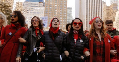"""Young women participate in """"A Day Without a Woman"""" march in New York, March 8, 2017. (Photo: Lucas Jackson/Reuters /Newscom)"""