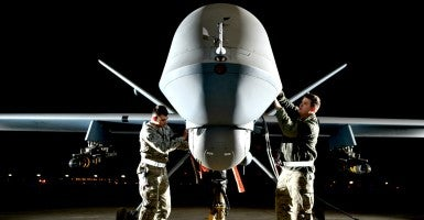 Airman 1st Class Steven and Airman 1st Class Taylor prepare an MQ-9 Reaper for flight during exercise Combat Hammer, May 15, 2014. (Photo: U.S. Air Force photo/Staff Sgt. Nadine Barclay)