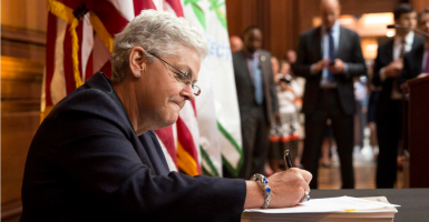 Environmental Protection Agency (EPA) Administrator Gina McCarthy signs a proposal under the Clean Air Act to cut carbon pollution from existing power plants during a news conference in Washington June 2, 2014. (Newscom/REUTERS/Joshua Roberts)