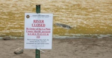 "A ""river closed"" sign appears on the Animas River due to toxic waste released by the EPA at the King Gold mine in Silverton, Colo. (iStock/KaraGrubis)"