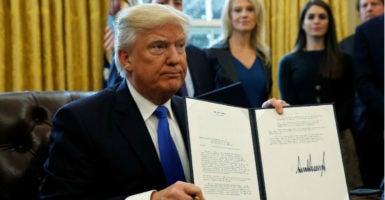President Donald Trump signed executive orders approving the construction of key pipelines after years of delay and rejection by the Obama administration. (Photo: Kevin Lamarque /Reuters/Newscom)