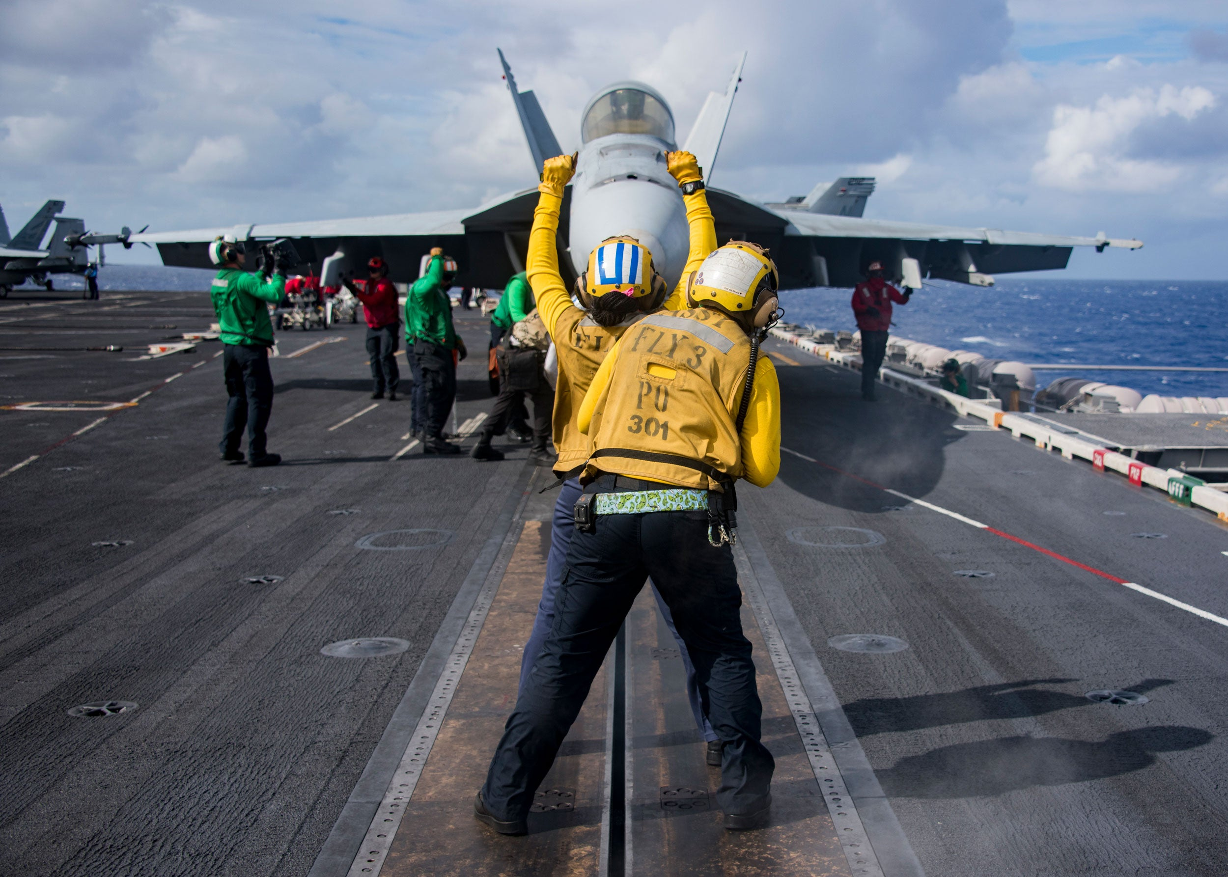 An F/A-18 Hornet prepares for takeoff on a U.S. carrier. (Photo: Petty Officer 3rd Class Sean Castellano)