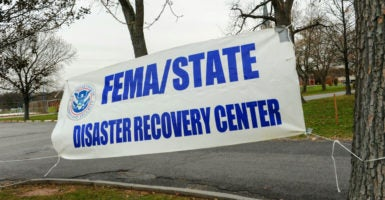 An outdoor sign marks the location of a FEMA center during a nor'easter in Staten Island, New York. (Photo: Stephanie Keith/Polaris/Newscom)
