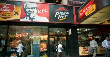Signs for an assortment of fast food franchises located in one storefront in New York (Photo: Richard B. Levine/Newscom)