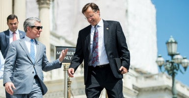 House Freedom Caucus member Rep. Dave Brat, R-Va., (right), talking with Rep. Scott Rigell, R-Va., left, is pushing for leadership candidates to live up to their promises. (Photo: Bill Clark/CQ Roll Call/Newscom)