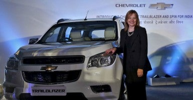 "General Motors Chief Executive Officer Mary Barra poses next to the company's ""Trailblazer"" sports-utility vehicle during a news conference in New Delhi, India, July 29, 2015.  (Photo: ANINDITO MUKHERJEE/REUTERS/Newscom)"