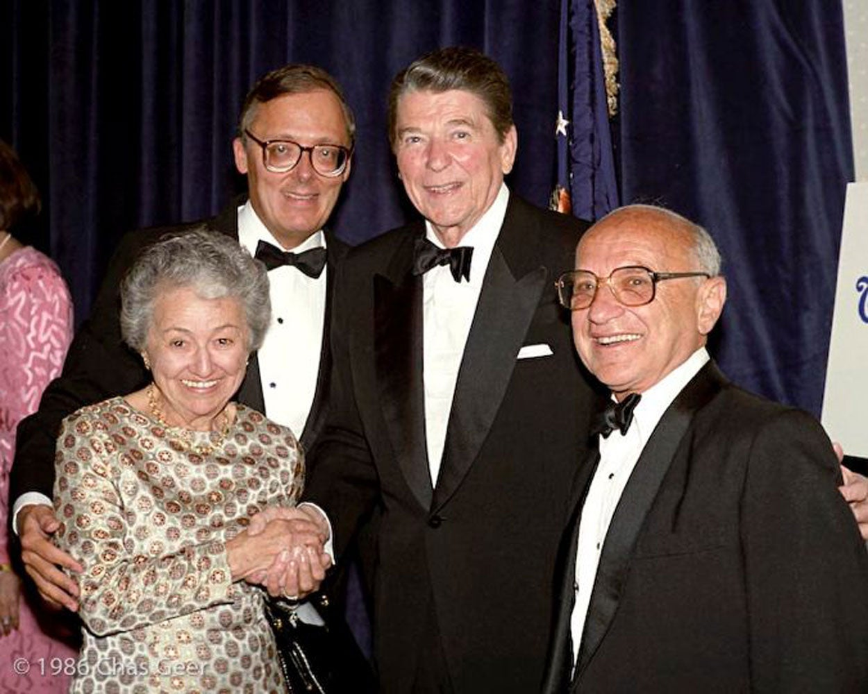 Ed Feulner and President Ronald Reagan are flanked by Rose and Milton Friedman in 1986. (Photo: Charles Geer for The Heritage Foundation)