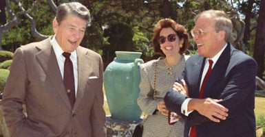 "Ed and Linda Feulner with former President Ronald Reagan. Feulner traces his optimism in large part to what Reagan often said, ""Trust the people."" (Photo: Charles Geer for The Heritage Foundation)"
