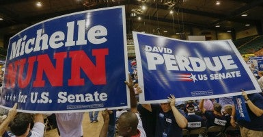 Polls show Georgia's Senate race so tight that it's bound to go to a runoff in January. (Photo: Newscom)