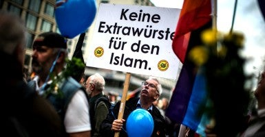 "Nov. 7, 2015 - Berlin, Berlin, Germany: A demonstrator holds a placard that reads: 'No extra sausages for Islam' by using the German phrase Extrawurste (extra pork sausage). According to police about 5000 people took part in a protest rally of the German right wing party 'Alternative fuer Deutschland, AfD' (Alternative for Germany). The anti-immigration party has staged a march in Berlin against German chancellor Angela Merkel government's migrant policies, with demonstrators chanting ""Merkel must go"".  (Photo: Hermann Bredehorst/Polaris/Newscom)"