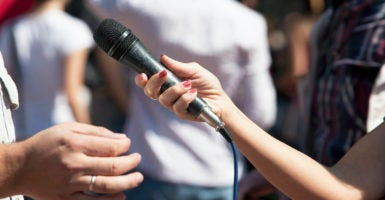 Reporter holding microphone