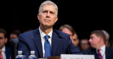 Judge Neil Gorsuch attends the first day of his Supreme Court confirmation hearing before the Senate Judiciary Committee, hours after facing new allegations from a former female student. (Photo: Bill Clark/CQ Roll Call/Newscom)