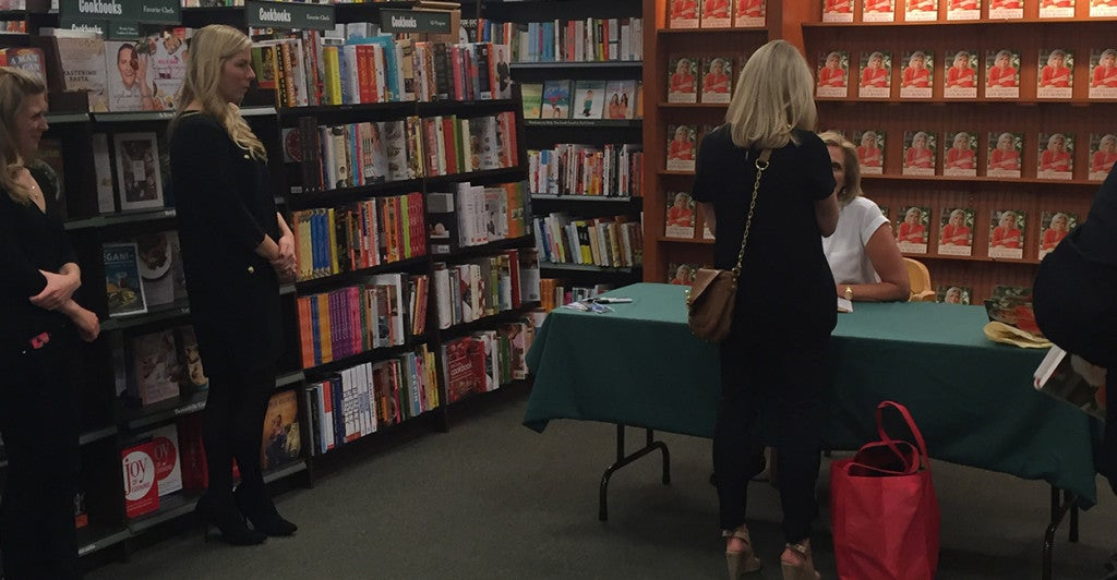 """Grafton Pritchartt approaches Ann Romney at Tuesday's book signing for """"In This Together."""" (Photo: Madaline Donnelly/The Daily Signal)"""