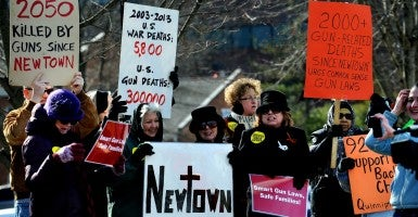An anti-gun rally in front of the National Rifle Association (NRA) office. (Photo: Olivier Douliery/ABACAUSA/Newscom)