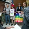 Activists against HB2 start a peaceful protest outside the office of House Speaker Tim Moore at the State Legislative Building in Raleigh, N.C., on Monday, April 25, 2016. (Robert Willett/Raleigh News & Observer/TNS)