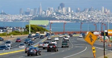 Traffic against San Francisco skyline. (Photo: Rafael Ben-Ari/Chameleons Eye/Newscom)