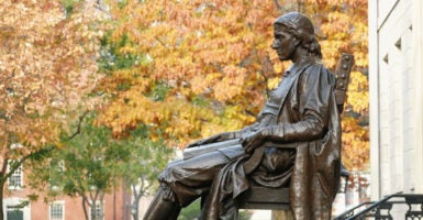 Founded in 1636, Harvard College took its name from English clergyman John Harvard, whose statue sits today in Harvard Yard. (Photo: iStock Photos)