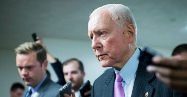 Sen. Orrin Hatch, R-Utah, speaks with reporters in the Senate subway as he arrives for a vote in the Capitol on Tuesday, July 14, 2015. (Photo Bill Clark/CQ Roll Call/Newscom)