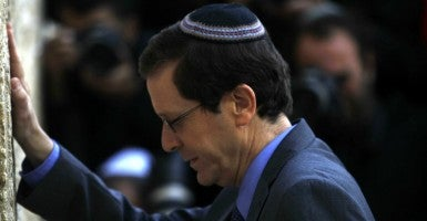 Isaac Herzog, co-leader of the Zionist Union party, prays at the Western Wall in Jerusalem March 15 before Israelis go to the polls in the general elections on Tuesday. (Muammar Awad/Newscom)