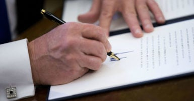 President Donald Trump signed a memorandum to all heads of executive departments and agencies, directing them to refrain from filling any positions that remained open as of noon on Jan. 22. (Photo: Shawn Thew/SIPA/Newscom)