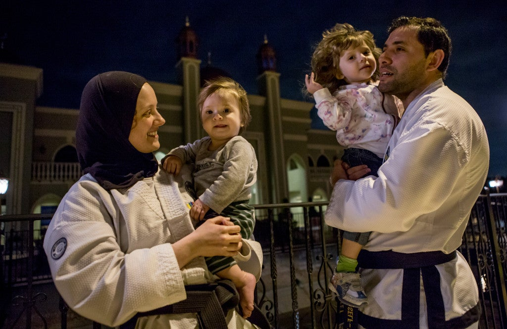 Alyssa Alfaleet (left) married her husband, Raed, and converted to Islam. The couple is raising their two children to be accepting of other religions. (Photo: Scott Dalton)