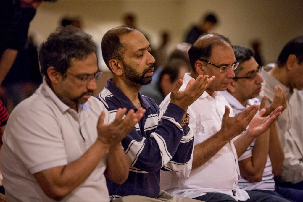 "Haroon Dosani (third from left) helps lead interfaith events at the Maryam Islamic Center in order to ""break the stigma"" of being Muslim. (Photo: Scott Dalton)"