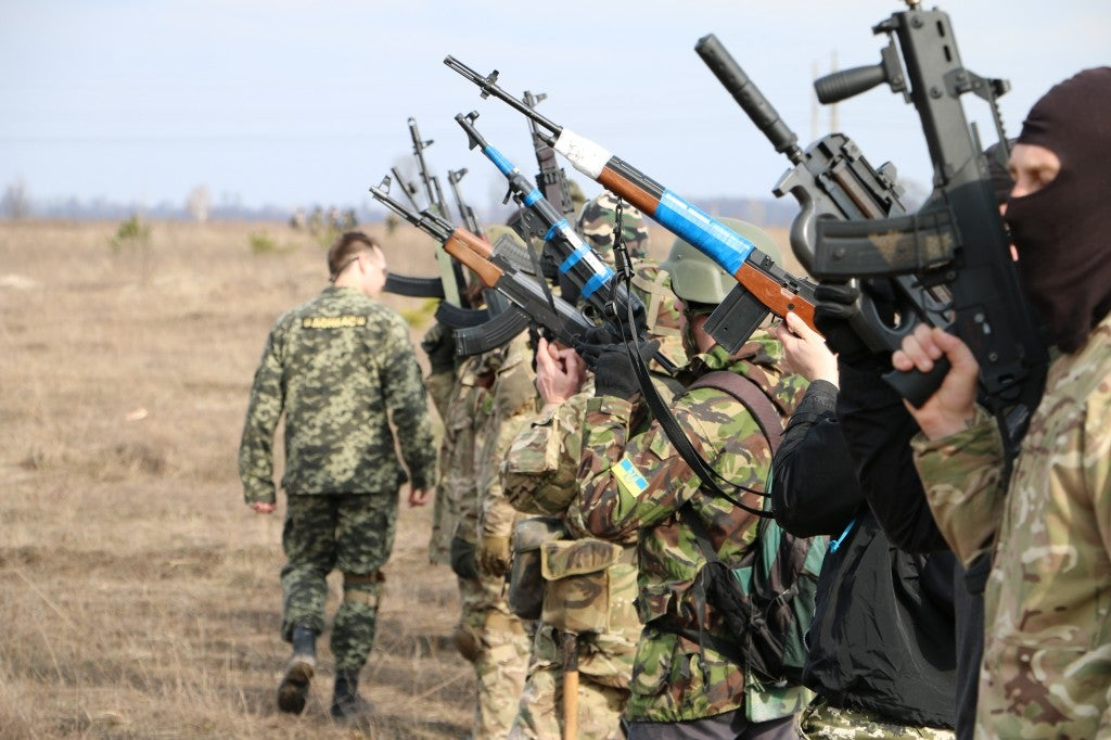 Members of the 318th Kyiv Territorial Defense Battalion at a training exercise outside Kyiv in March. (Photo: Nolan Peterson/The Daily Signal)