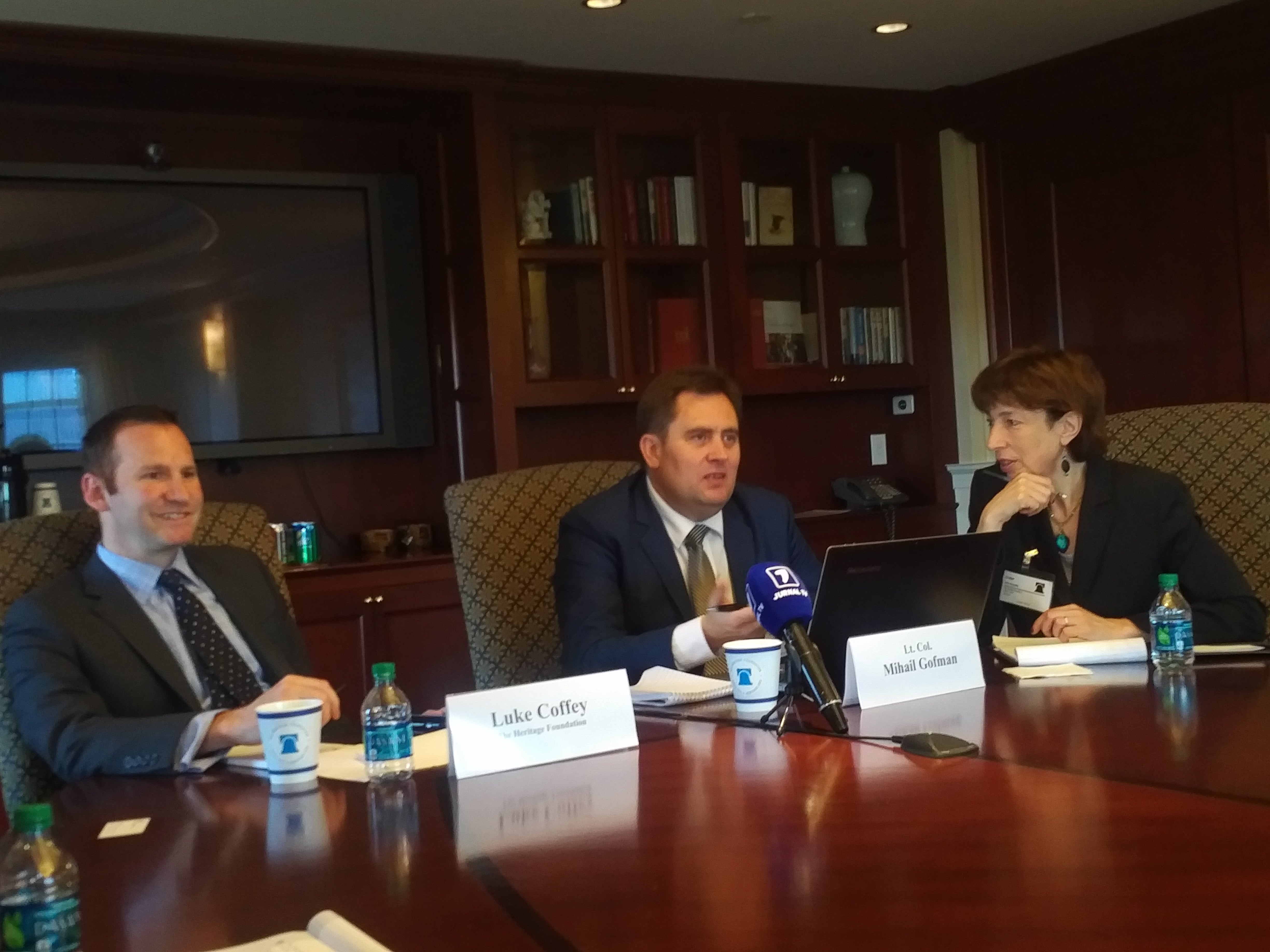 Mihail Gofman, middle, speaks at The Heritage Foundation.