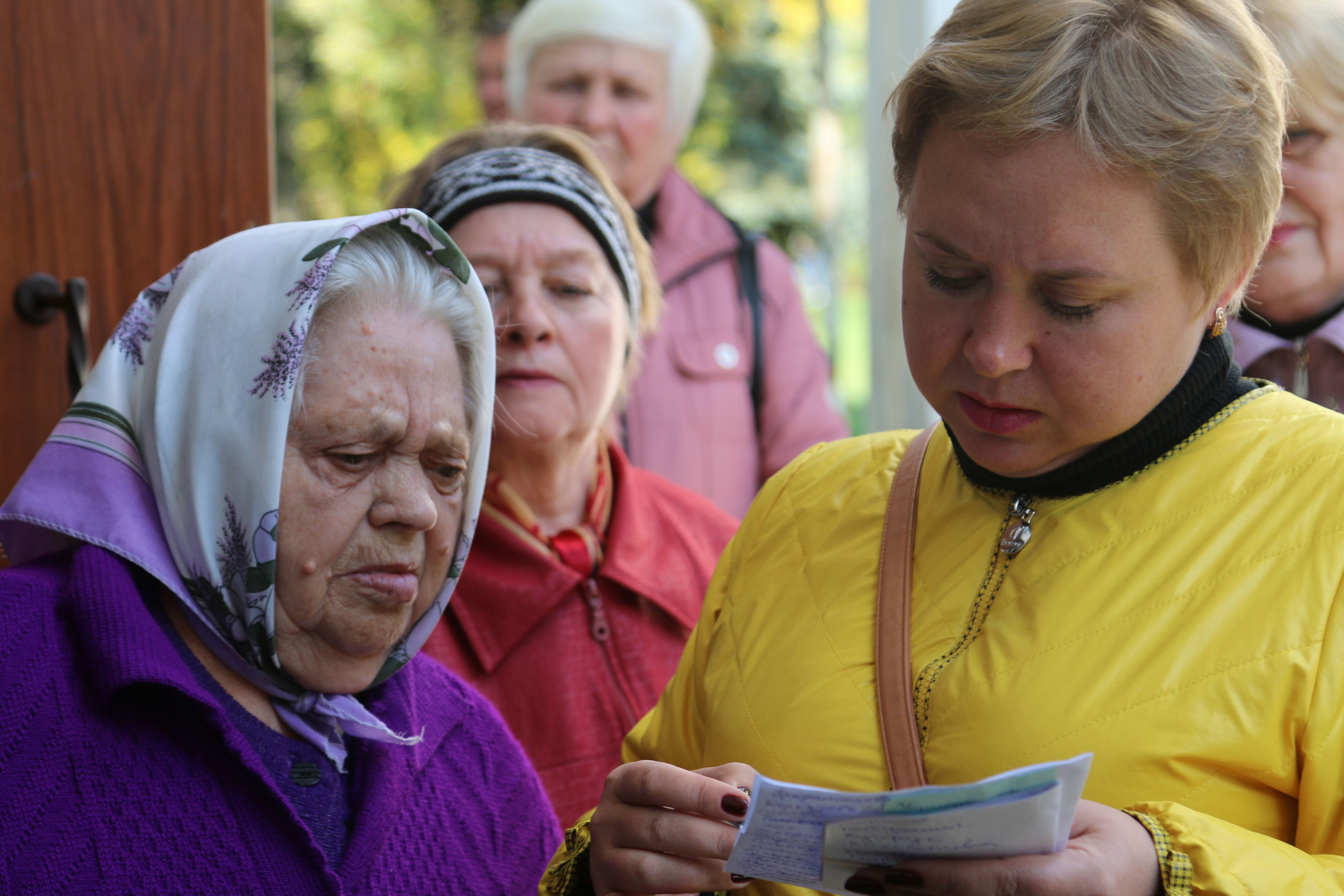 Displaced persons wait in line to receive U.N. food vouchers at a distribution center in Kurakhovo, Ukraine.