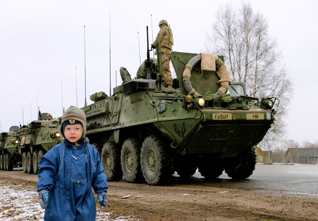 Estonian citizens welcome a U.S. Army Stryker convoy in March. (Photo: Nolan Peterson/The Daily Signal)