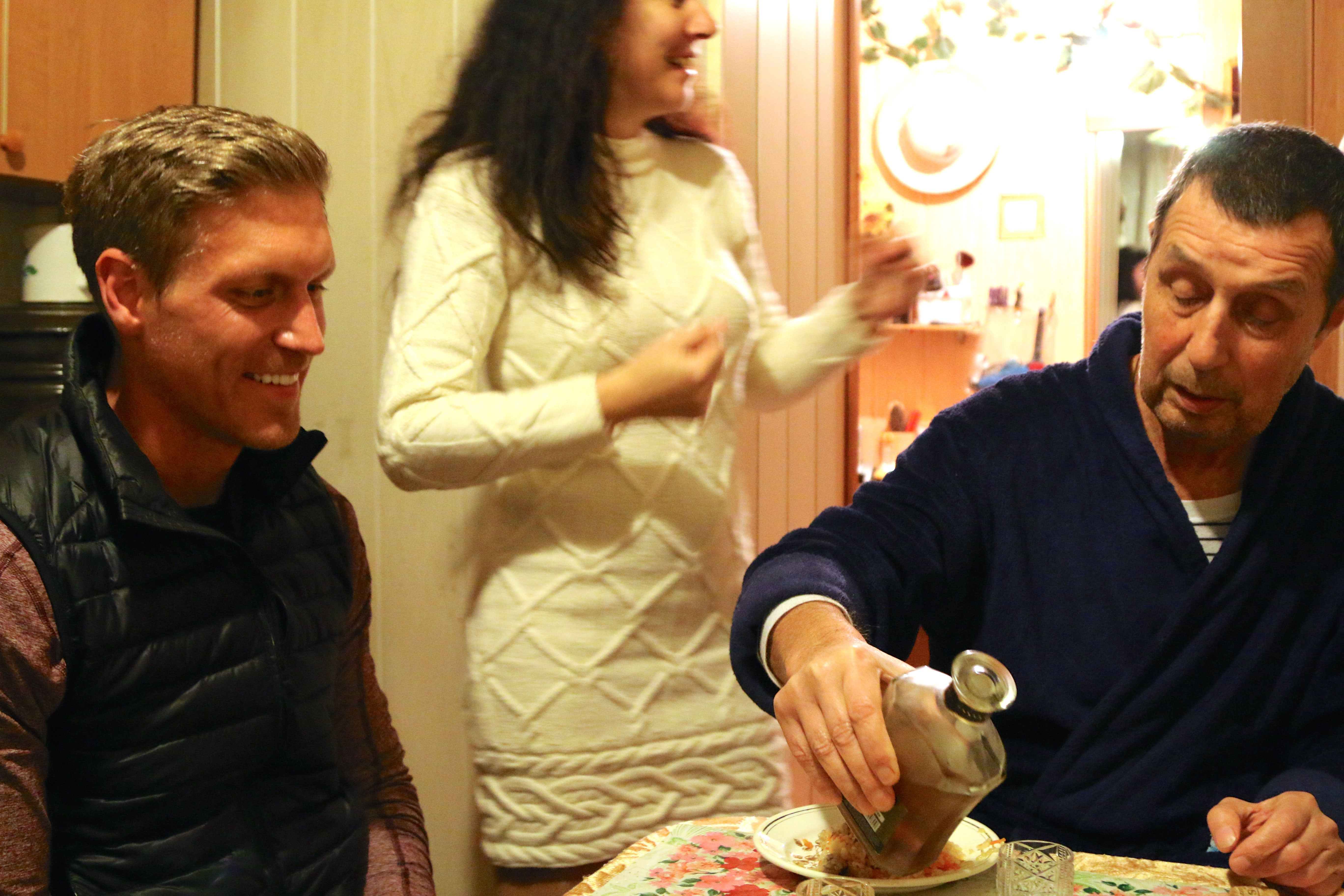 The author's brother, Drew, at dinner with a Ukrainian family in Marinka. (Photo: Nolan Peterson/The Daily Signal)