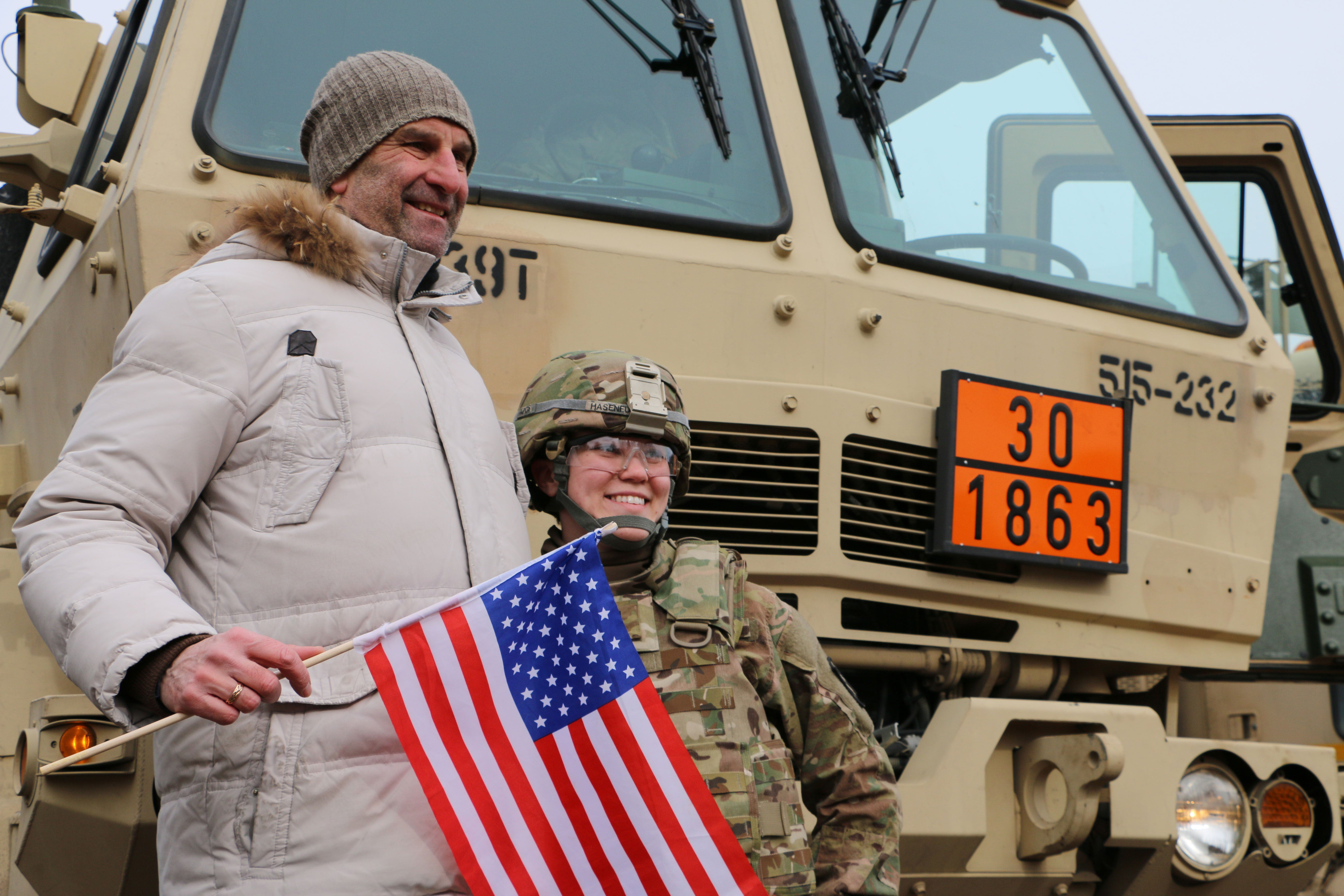 In Latvia, civilians welcome a U.S. Army Stryker convoy in 2015. (Photos: Nolan Peterson/The Daily Signal)