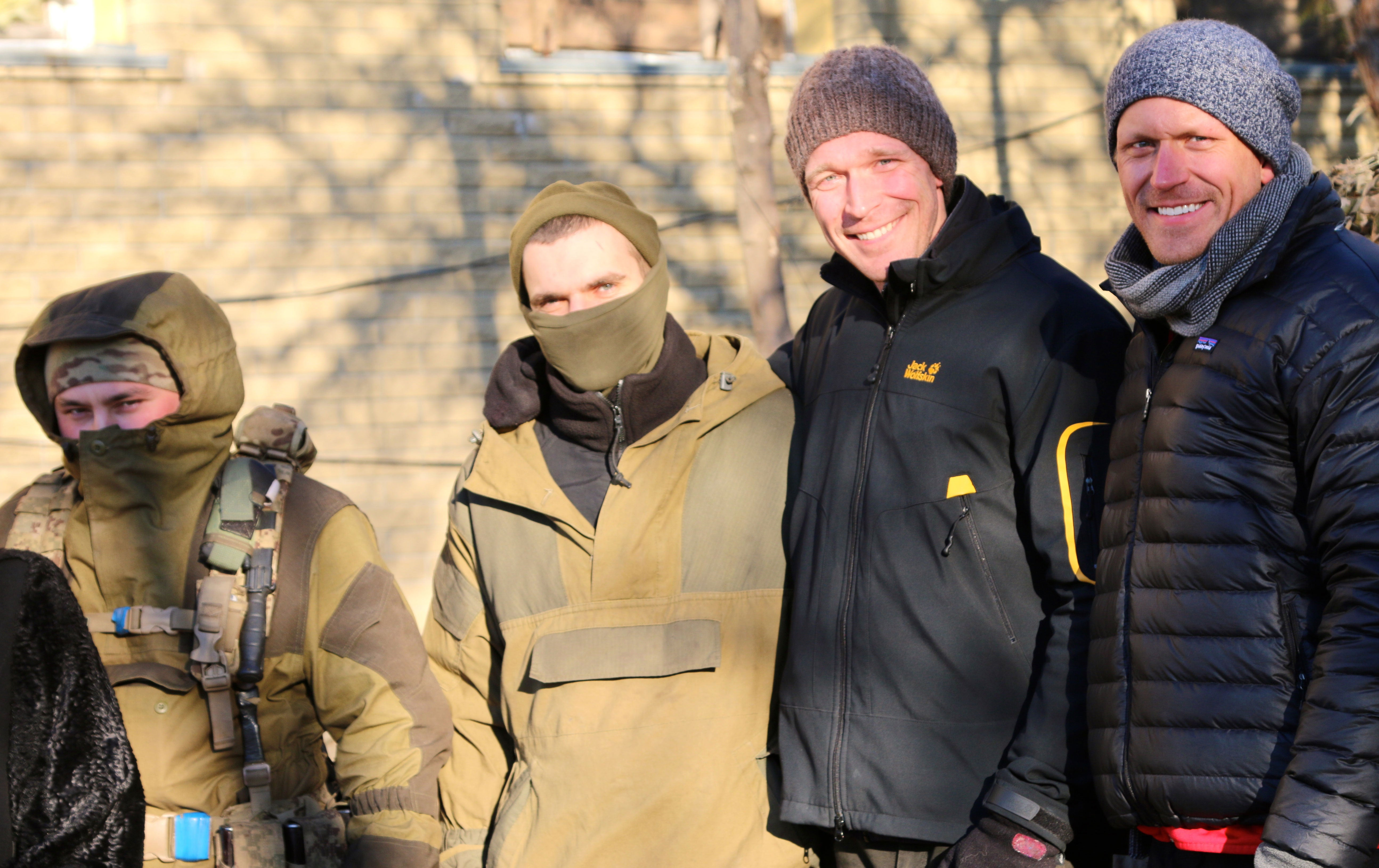 The author, second from right, and his brother, right, with Ukrainian soldiers in Marinka. (Photos: Nolan Peterson/The Daily Signal)