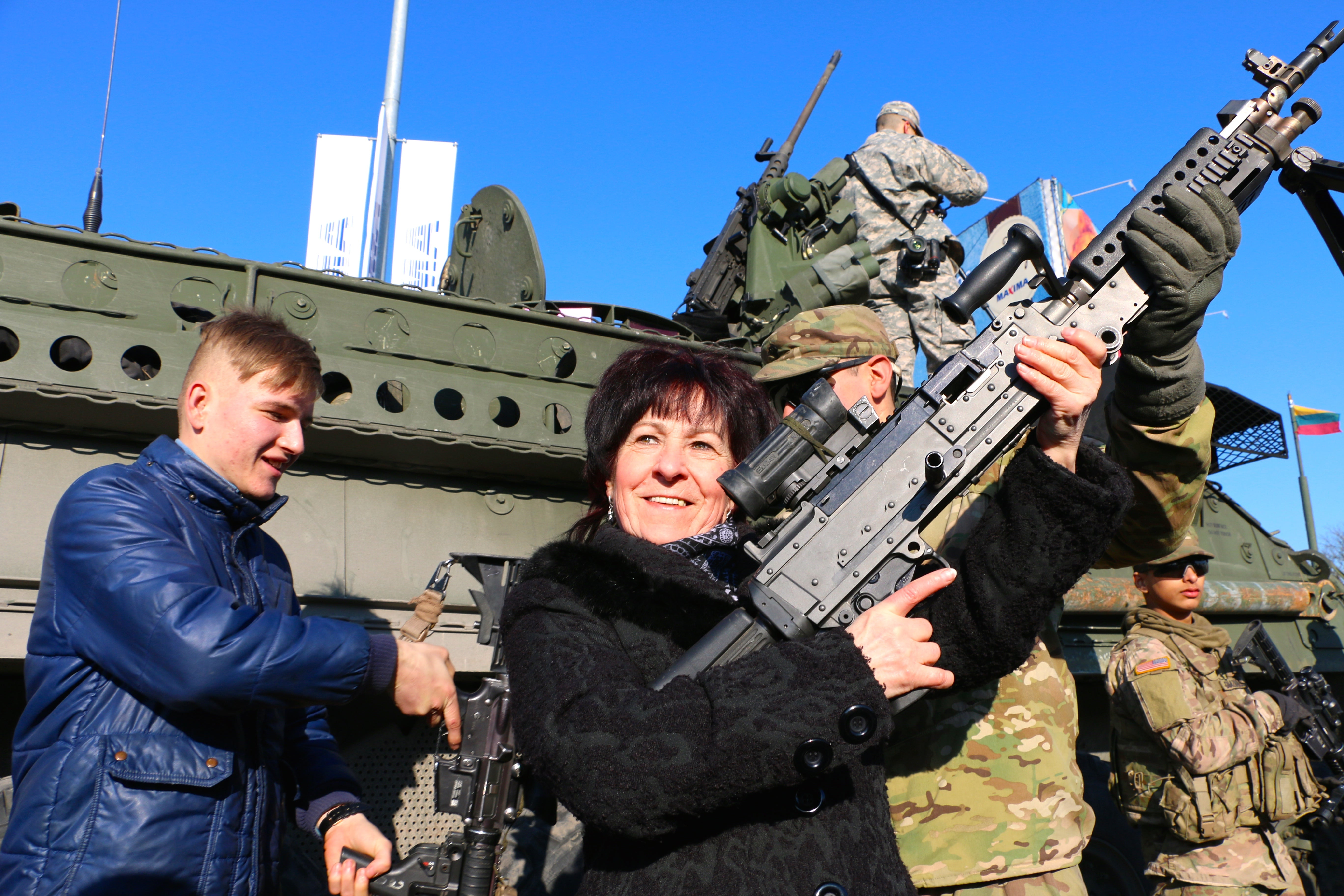 A Lithuanian woman at a U.S. Army Stryker static display in Marijampole, Lithuania on March 24. (Photo: Nolan Peterson/The Daily Signal)