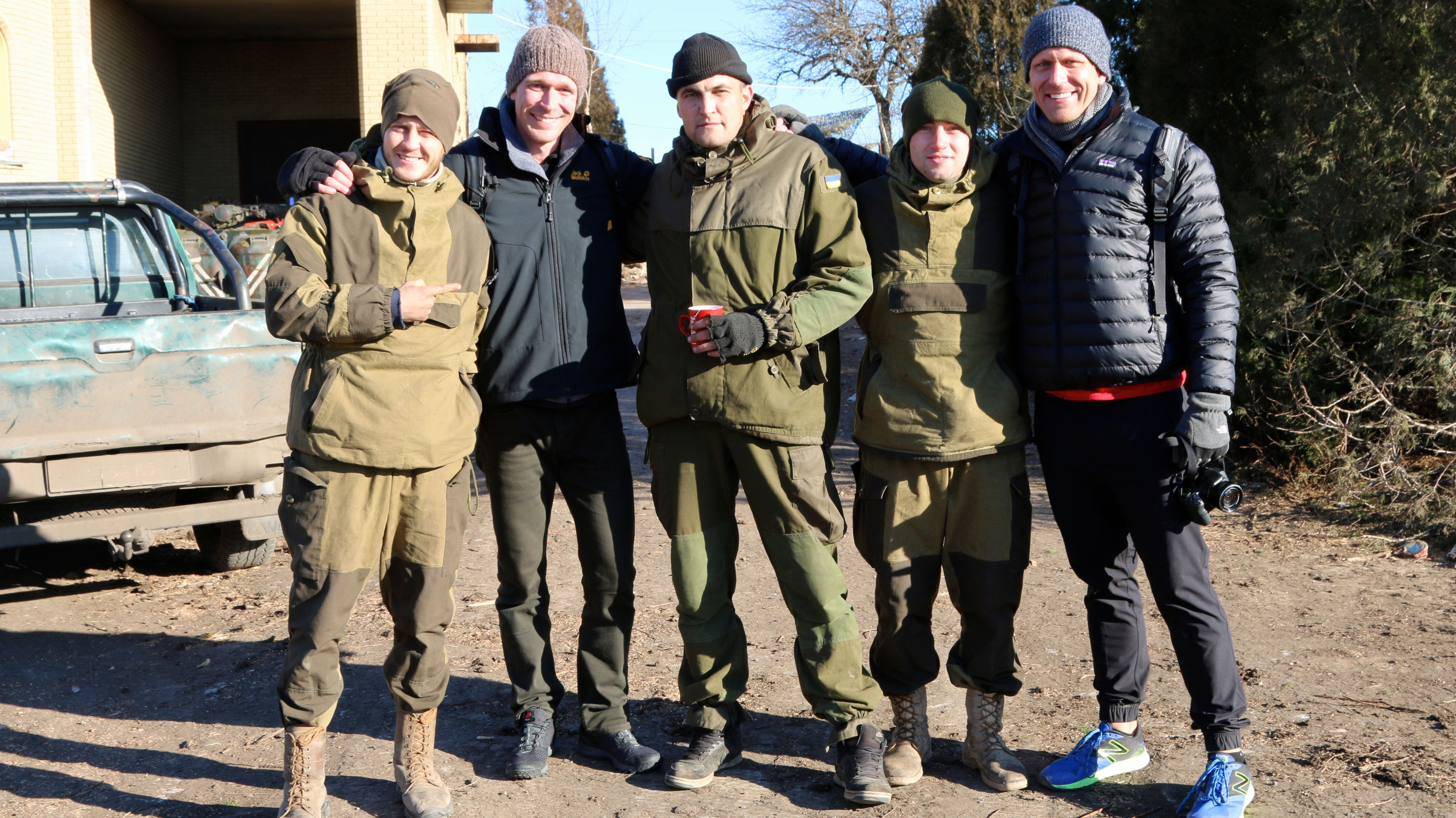 (0566) The author and his brother with Ukrainian soldiers in Marinka. (Photo: Nolan Peterson/The Daily Signal)